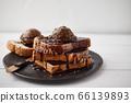 Chocolate ice cream on toast. 66139893