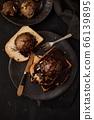Chocolate ice cream on toast. 66139895