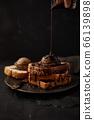 Chocolate ice cream on toast. 66139898