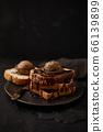 Chocolate ice cream on toast. 66139899
