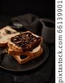 Chocolate cream on toast. 66139901