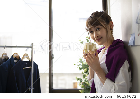 Woman relaxing with a drink 66156672
