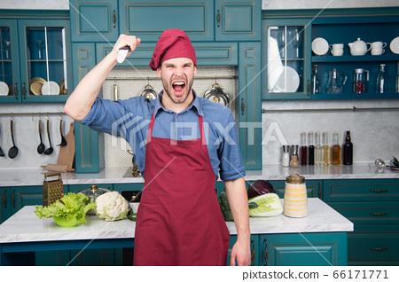 Man use sharp ceramic knife. Sharp knife 66171771