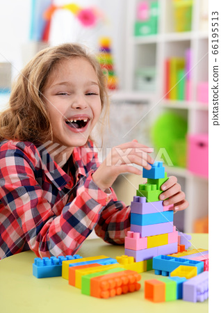 Happy cute little girl playing with cubes 66195513