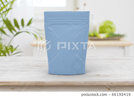 The blue food and snack pouch bag packaging mock-up design front view on wooden table 66198419