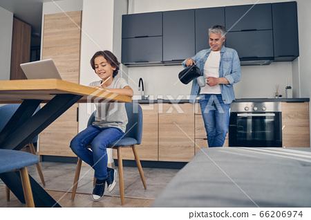Two family members enjoying comfort of home 66206974