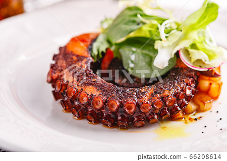 Close up of cooked octopus in a restaurant serving 66208614