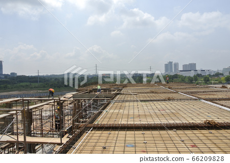 KUALA LUMPUR, MALAYSIA -MARCH 5, 2020:The construction site is operating during the day. Workers are busy carrying out their activities as planned under the supervisor's supervision. 66209828