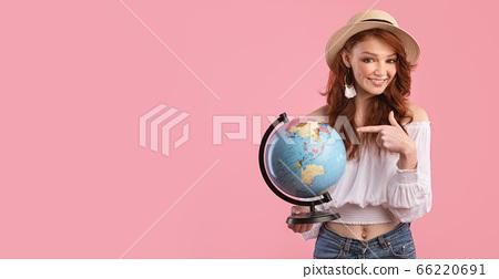 Smiling Girl Holding Globe Posing In Studio Over Pink Background 66220691