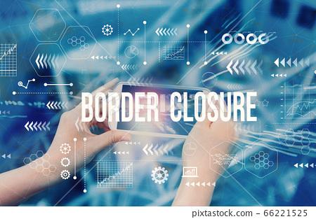 Border Closure Theme with person using smartphone 66221525