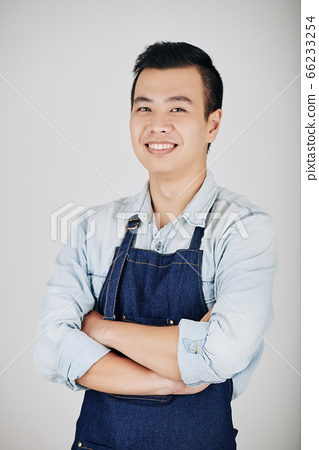 Handsome young Vietnamese waiter 66233254