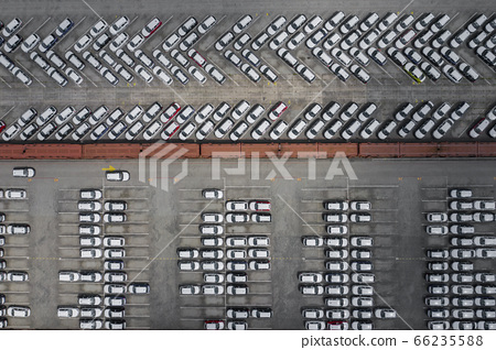 New car lined up aerial view. Port of import and export business logistic to dealership for sale. 66235588