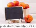 Apricot or peach in wooden box as healthy snack 66255933
