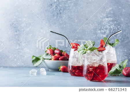 Red cocktail with ice and fresh strawberry 66271343