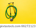 Top view of green medical stethoscope on colorful 66272123