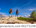 Couple with backpack on mountain top. Two people 66273298