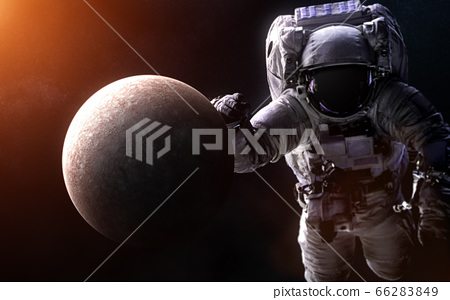 Mercury on a blurred background with a giant astronaut. Solar system 66283849