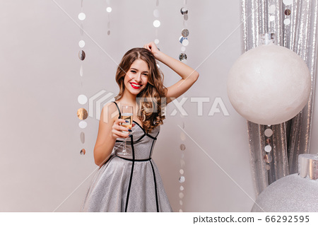 Fashionable smiling girl drinking champagne near 66292595