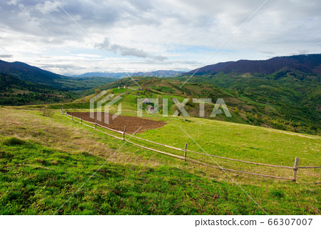 rural fields on mountain hills. beautiful rural 66307007