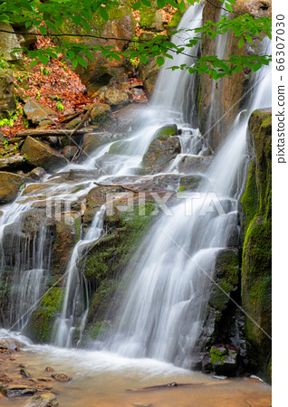 rocks in waterfall stream. beautiful nature 66307030