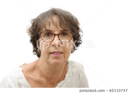 Portrait of mature smiling brunette woman 66310747