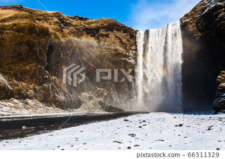 Skogafoss view during winter snow which located in Skoga River in South Iceland 66311329