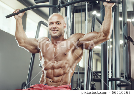 Bodybuilder athletic man workout muscles exercise. 66316262
