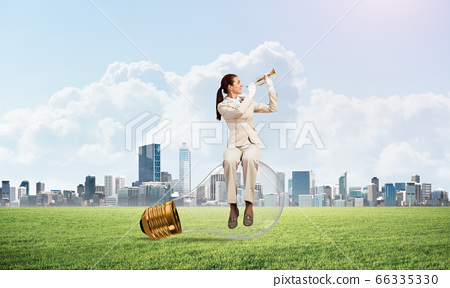 Attractive woman playing trumpet brass 66335330