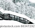 The bridge at old salt mine of Hallstatt Winter 66347292