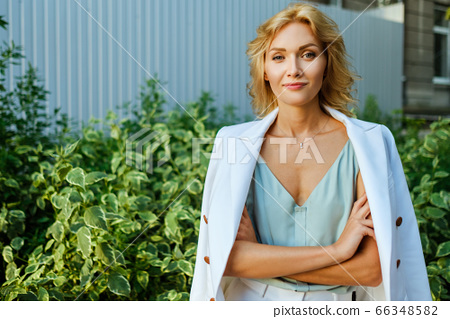 Portrait of attractive business lady in white suit 66348582