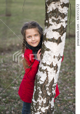 girl near birch 66355172