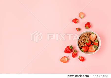 Top view breakfast bowls with granola, milk and 66356368