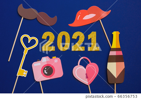 Happy New year 2021 celebration. Gold numeral 2021 on dark blue background. 66356753