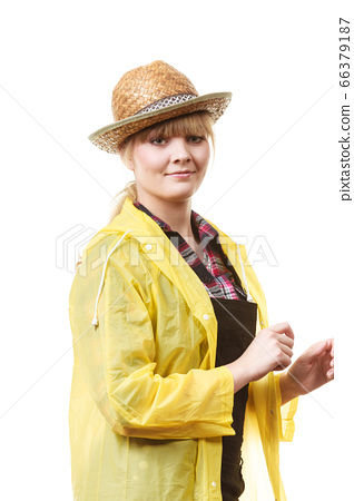 Happy smiling gardener in sun hat and raincoat 66379187