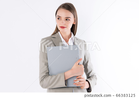 Working woman is holding her folder with smart outfit. 66383125