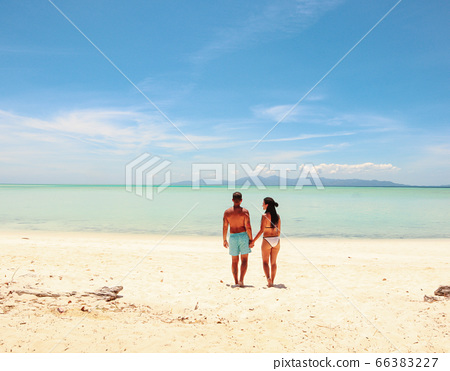 Paradise with white sandy beach, turquoise water and palm trees in Onok Island in Balabac Philippines  66383227