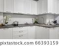 Clean and minimalistic modern white kitchen interior 66393159