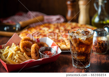 ice cold cola with pizza and french fries 66398854