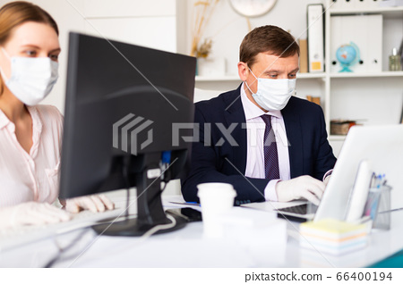Office workers in protective medical masks 66400194