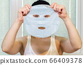 Woman Skin Care.Woman holding beauty mask 66409378