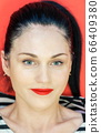 Portrait of woman with makeup and red lips 66409380