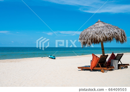 Two Chairs Under Parasol In Tropical Beach 66409503