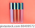 Four lipsticks in various colors 66409572