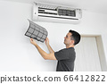 The guy cleans the filter of the home air 66412822