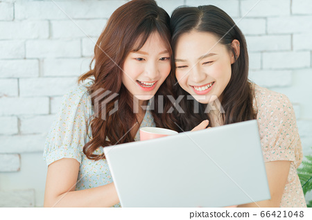 Two woman doing exercise at home 66421048