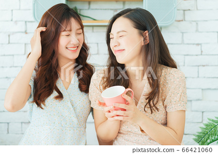 Two woman doing exercise at home 66421060