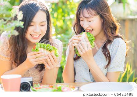 Women, eating, nature 66421499
