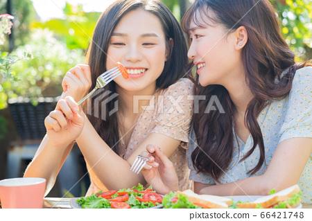 Women, eating, nature 66421748