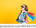 woman teen smiling standing with sunglasses 66446249