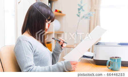 Woman confirming documents Various documents Application proof Application Invoice Application resume 16:9 66446283